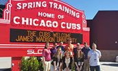 SRM Baseball Camp Group in front of Chicago Cubs Training Sign in March 2016