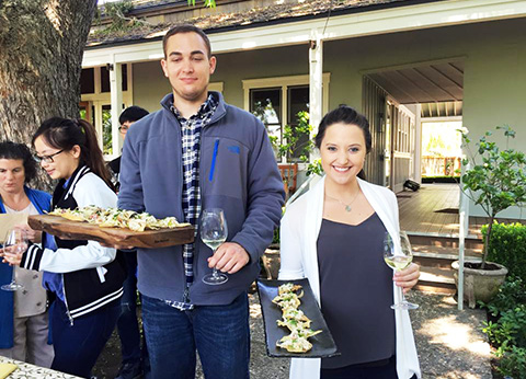 HM Students holding plates of food at the Napa & Sonoma Wine & Culture Course Trip