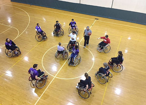 SRM Students learning to play wheelchair basketball