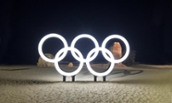 Olympic sign in snow at night - 2018 Winter Olympic Games - PyeongChang