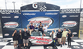 SRM Students posing in the Richmond International Raceway Victory Lane - 2017