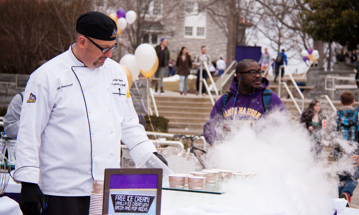 JMU Dining Services chef serving ice cream of the future: vanilla with bacon and pop rocks.