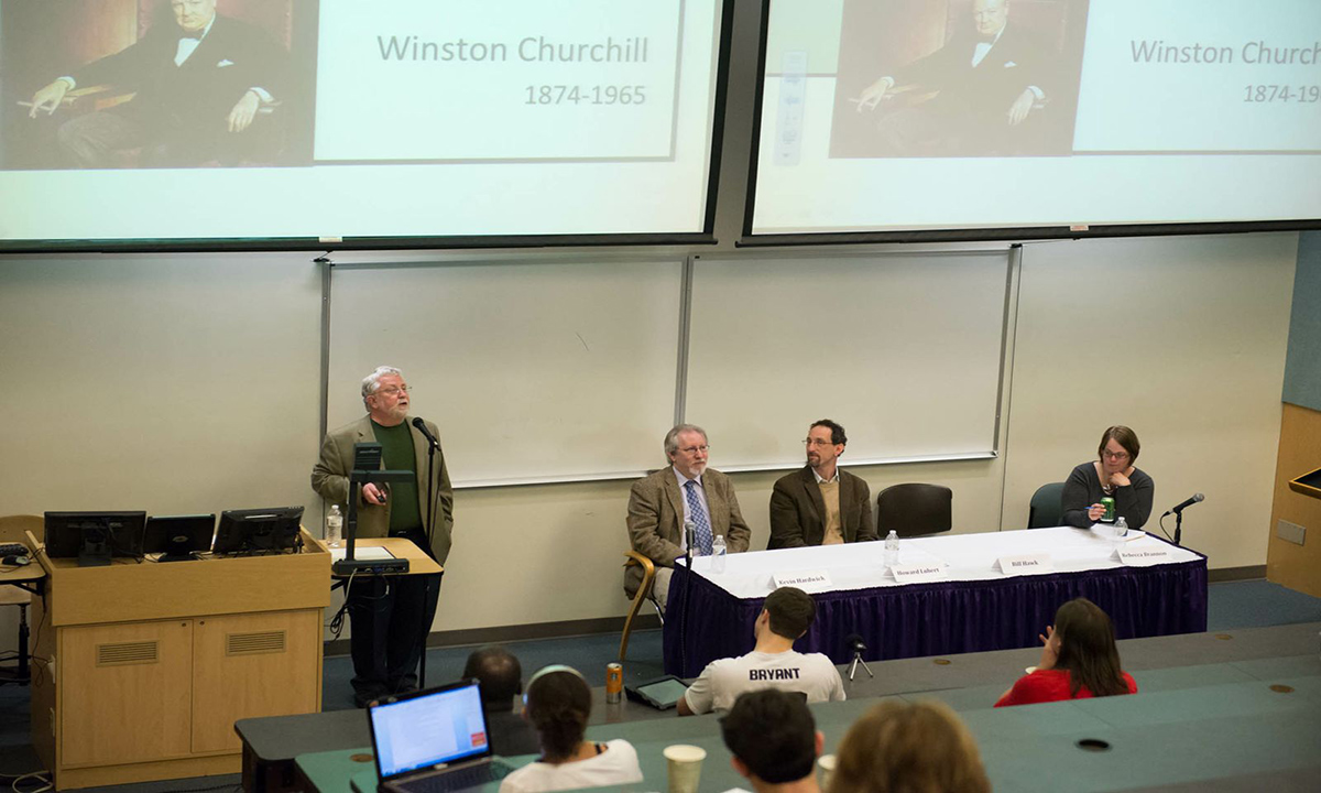 William Hawk (philosophy and religion) tells the audience how the political ideals of James Madison shaped the nation. Other participants (L-R): Kevin Hardwick (history), Howard Lubert (political science) and moderator Rebecca Brannon (history).