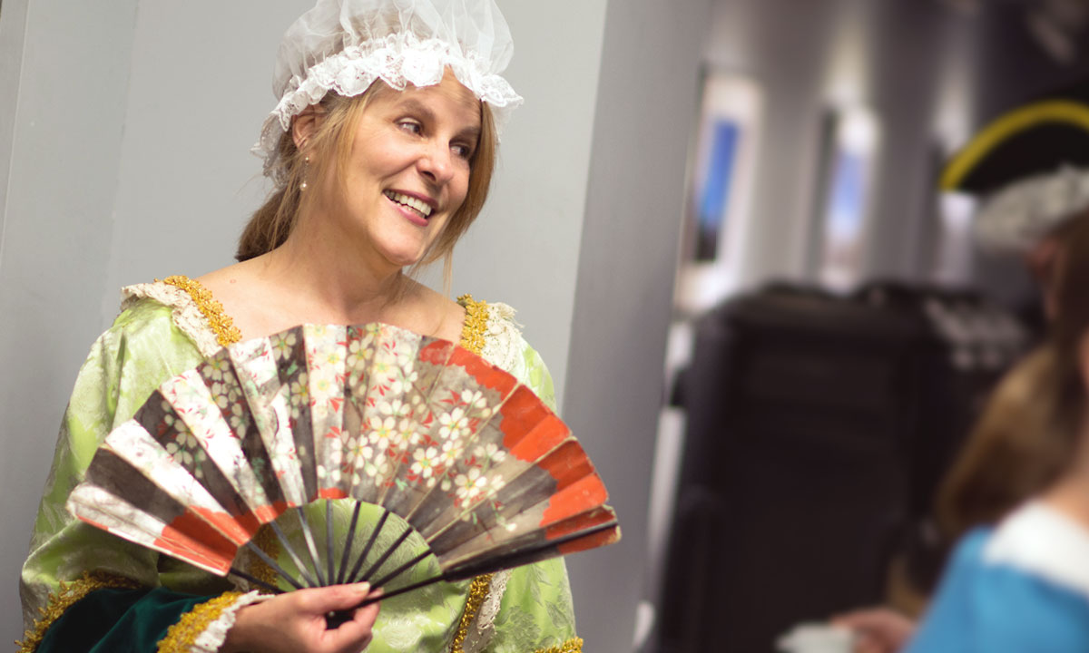 Shari Scofield, coordinator for Mad4U, got into the spirit of Colonial Tea Time.