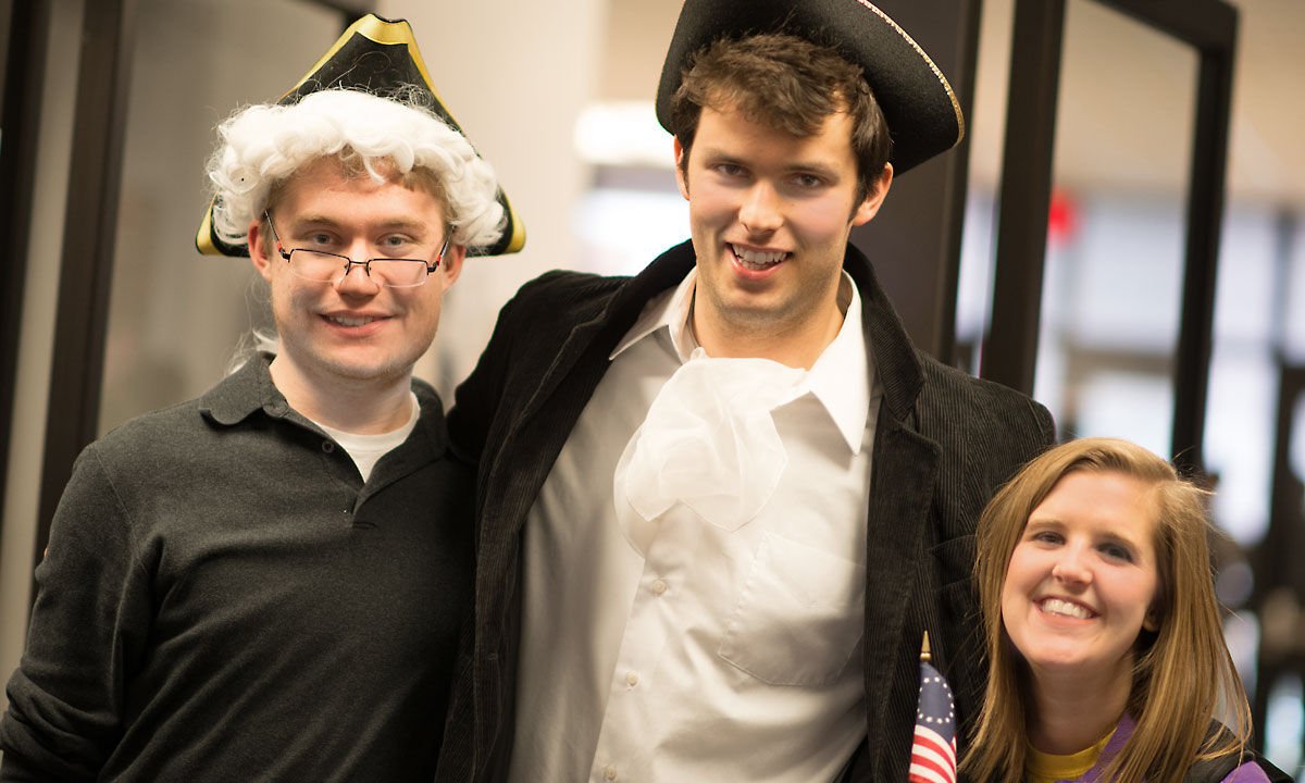 Student employees donned colonial garb to welcome students, faculty and staff to Tea Time.
