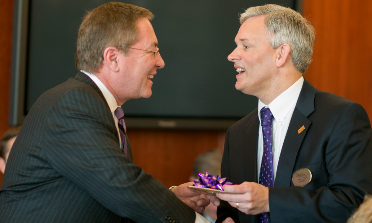 Greater Madison President Jim Sipe Jr. presented President Alger, an avid coin collector, with a set consisting of a James Madison $1 Presidential Coin, and a Bronze Medal bearing the likeness of Dolley Madison.
