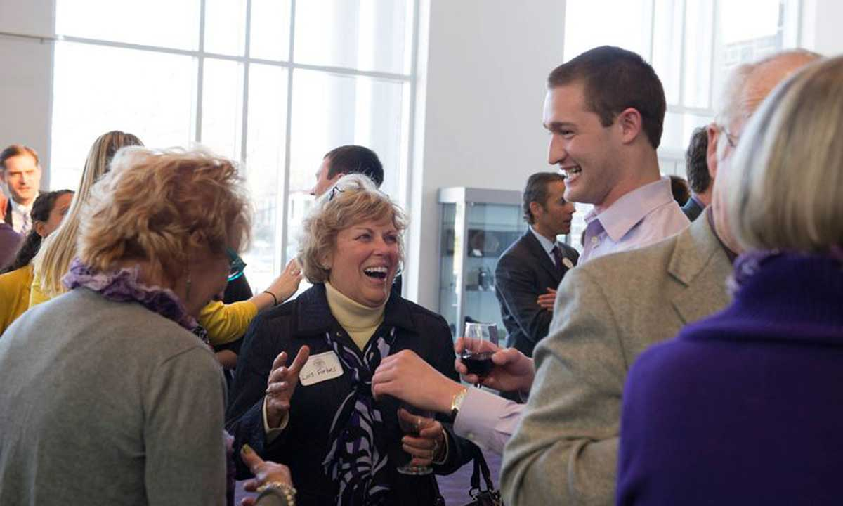 Lois Cardarella Forbes ('64) chats with alumni at reception. Longtime JMU supporters Forbes and her husband, Bruce, funded the Forbes Center, donated a James Madison statue and established a Forbes Family Scholarship.