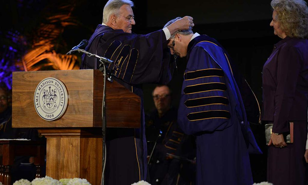 Rector Joseph Funkhouser places the chain of office over the head of President Jon Alger after the investiture.