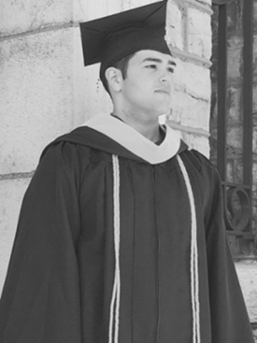 photograph of Ryan Harris in his cap and gown