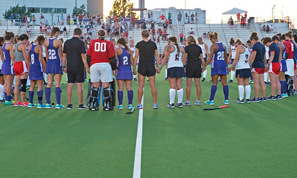 Field hockey team gathers before a game