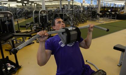 JMU trainer works out using equipment designed by JMU coaches
