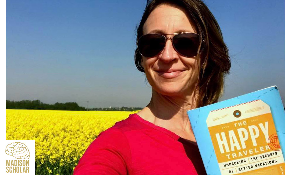 publicity photo of Kurtz holding her book with a field of yellow flowers and blue skies in the background