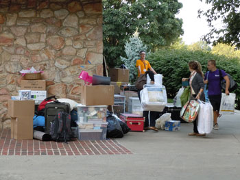 Photo of students moving into residence halls.