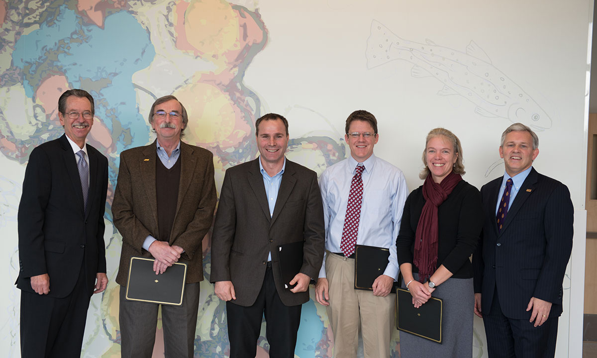 JMU Provost Jerry Benson stands with 4-VA grant recipients at the awards ceremony in the new bioscience building.