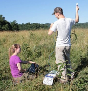 Photo of Bethany Meier working with Tim Kropp at a seismometer site