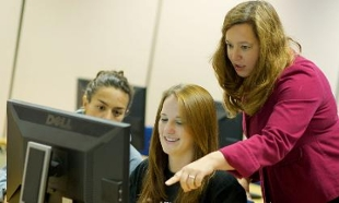 Dr. Theresa Clarke helps students with Google Online Marketing Challenge