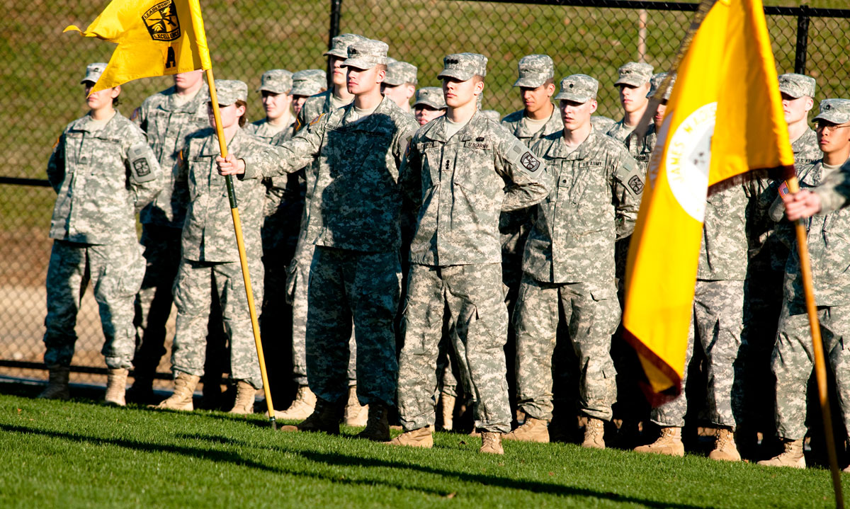 Army ROTC cadets stand at attention at military ceremony