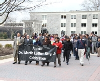 Students, faculty and staff participate in the MLK march