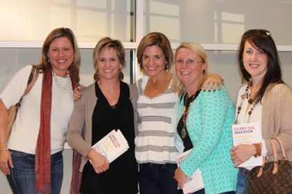 Glennon Melton poses with several women, some holding book titled