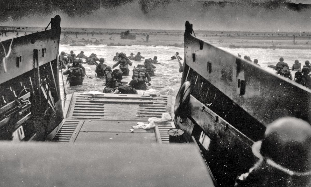 Associated Press black-and-white photo of a D-Day amphibious landing on a beach at Normandy, France