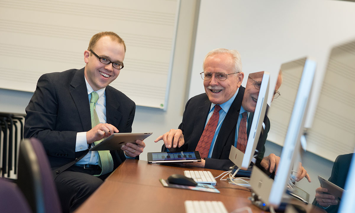David Stringham and Paul Ackerman use iPads to play music