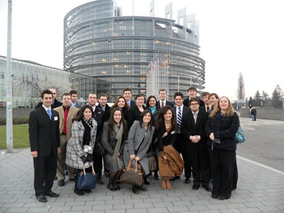 small group of students pose in front of the European Parliament building in Brussels, Belgium