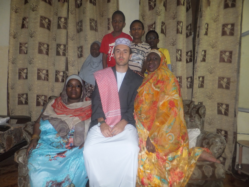 Andrew Reese in traditional African garb with African host family.