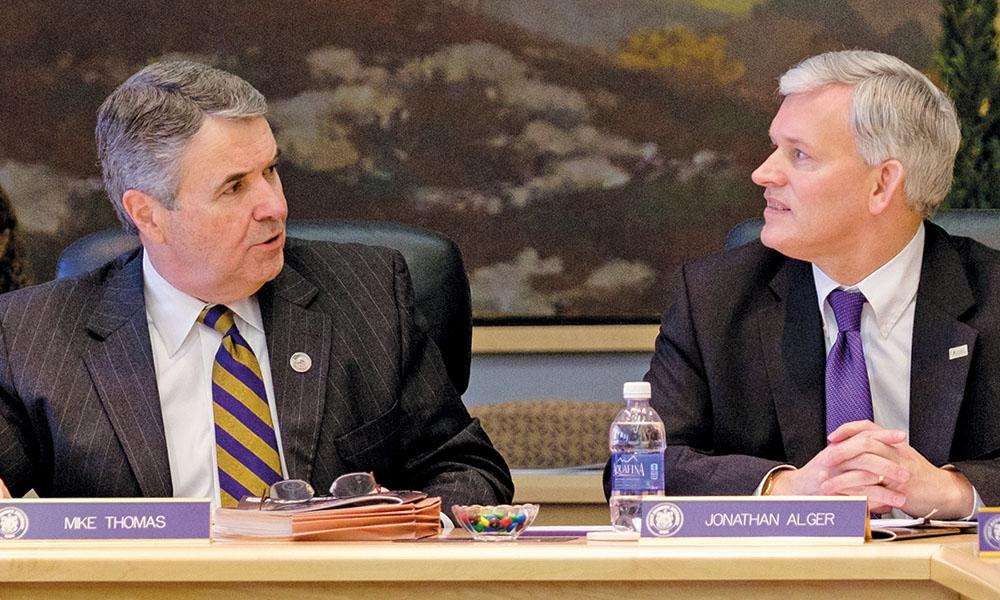 Mike Thomas ('76, '77M) and President Alger at a Board of Visitors meeting.