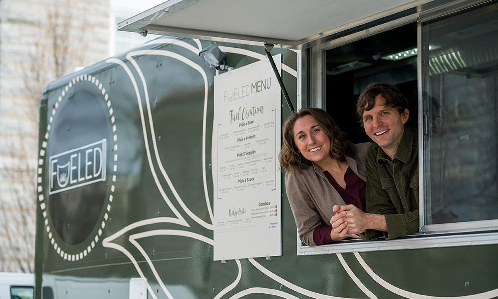 Amanda Presgraves ('16) and professor Mark Gabriele ('95) in the Fueled food truck.