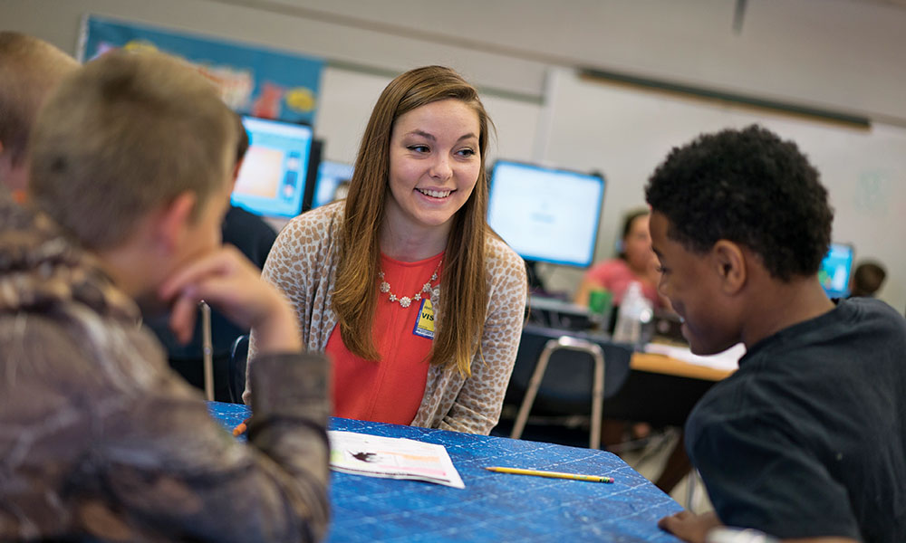 Allison Rhoten works with students in her class.