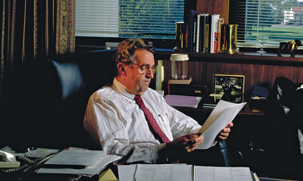 Image of Carrier at his office desk