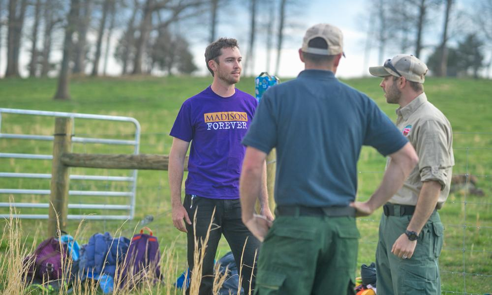 Adam Lynch chats with other farm conservation experts