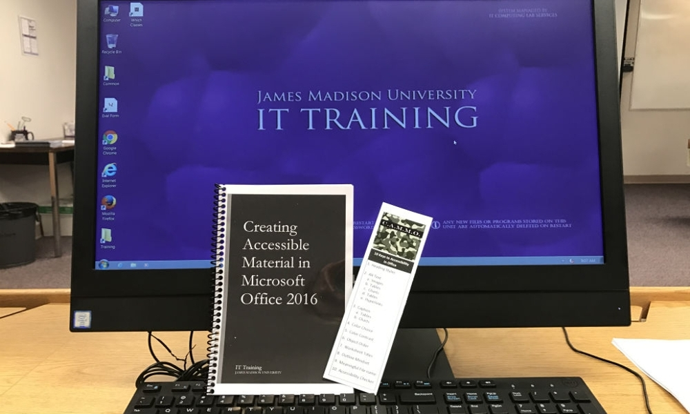 picture of a computer and training manual