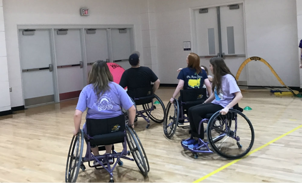 students playing wheelchair basketball