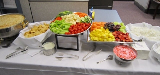 Table of food at the Open House: vegetable tray, fruits, etc.