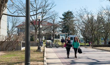 students walk by carrier library