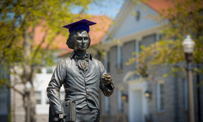 Image: James Madison statue wearing a graduation cap