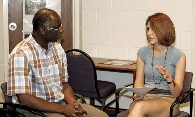 Dr. David Owusu-Ansah and student Kathleen Sensabaugh discuss