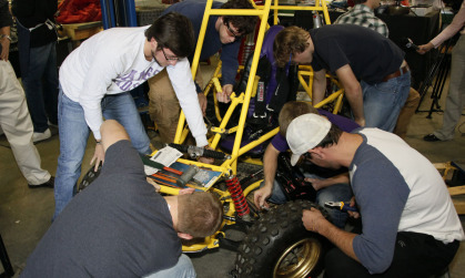 JMU students from a variety of disciplines working on a project in the Alternative Fuel Program lab.