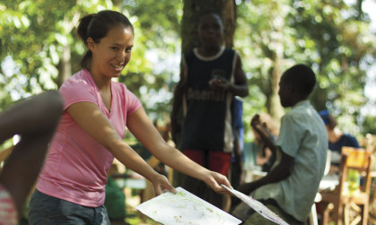 Leah Haling ('12) shares books with Kenyan schoolchildren. She helped install solar panels on Kenyan homes during summer 2011.