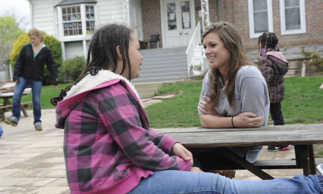 A JMU nursing student chats with a Harrisonburg child