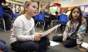 Two students read for their teacher