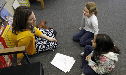 JMU professor Allison Kretlow working with elementary school students