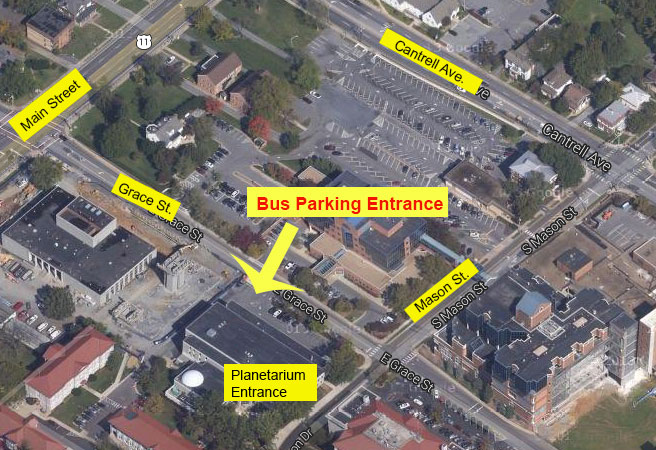 aerial map showing streets leading to the planetarium parking area. Map also has text and arrows.