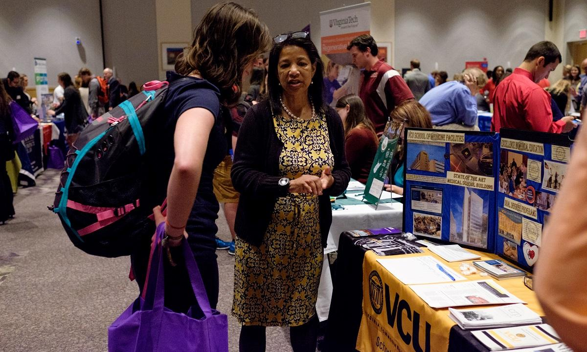 #JMUpreMed student networking with VCU School of Medicine at the annual Graduate & Professional School Fair