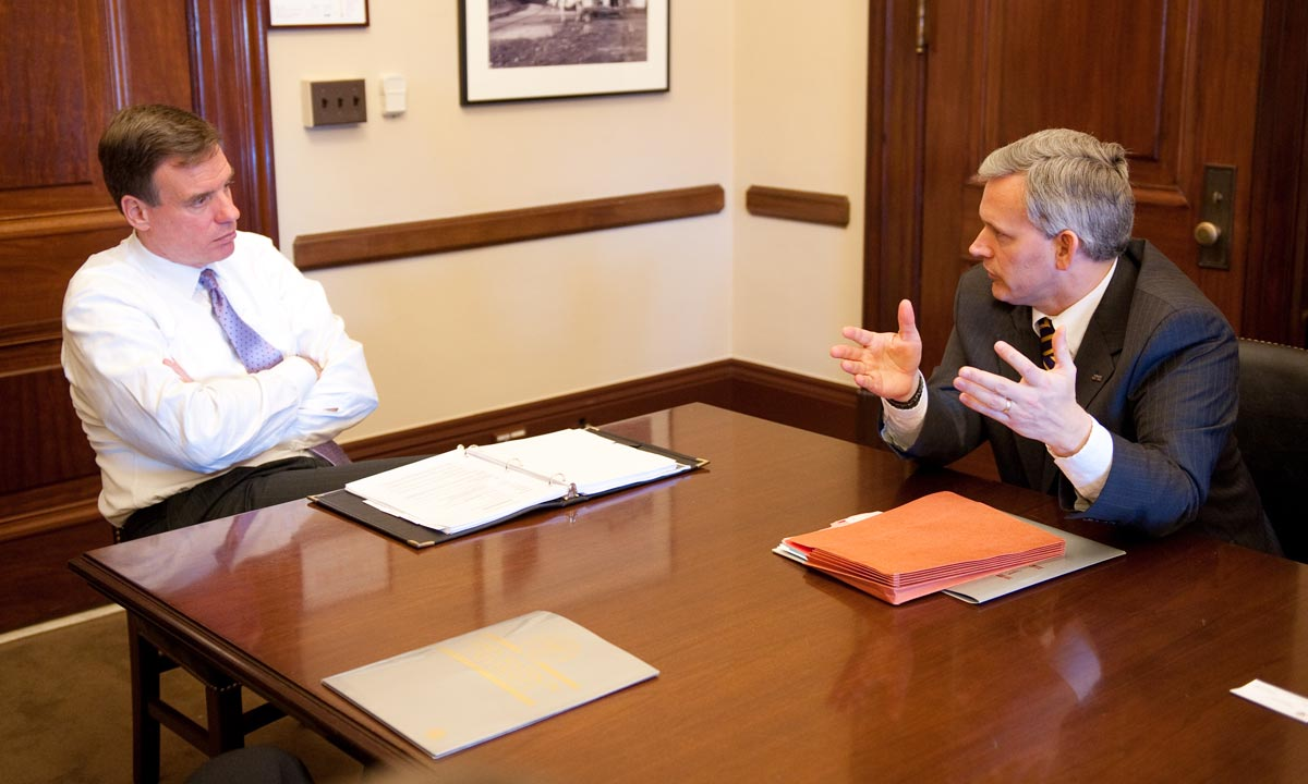 President Jonathan R. Alger talking with Senator Mark Warner