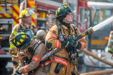 A JMU volunteer firefighter in action