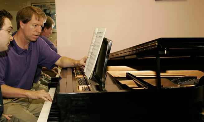 Photo of Professor Ruple and student during piano lesson