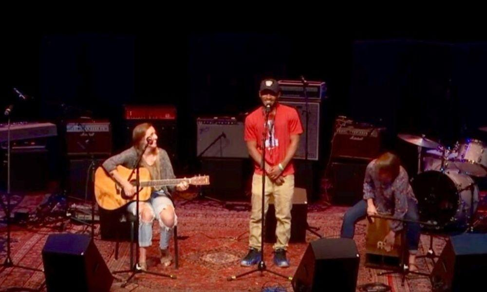 "(L to R) Lily Gates (JMU '20), then-Gemeinschaft Home resident Brian Hogan, and Rebecca Kenaga (JMU '20) perform Hogan's ""Mud Driving"" at Forbes Center for the Performing Arts in May 2018."