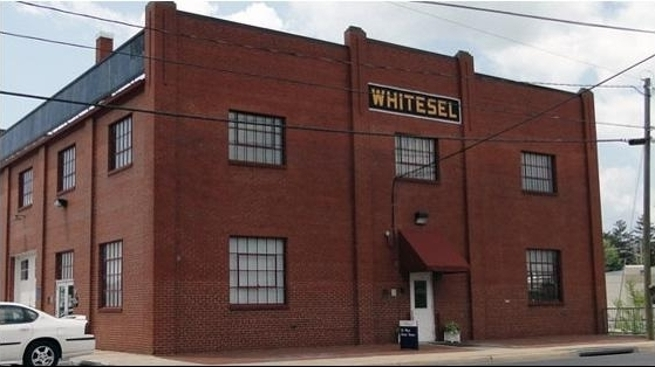 "Image: Located in <a href=""/directory/buildings/WB.shtml"" class=""slidelink"">the historic Whitesel Building</a>"